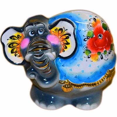 Слон-копилка с золотом